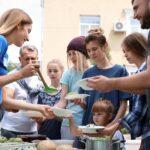 Volunteers Serving the Poor - 1 - Shutterstock