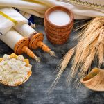 Torah and kippah on celebration traditional Jewish Holiday Shavuot for Kosher dairy product